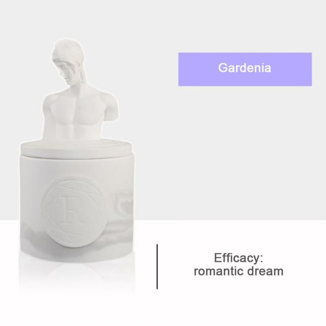Scented candle in a ceramic statuette container